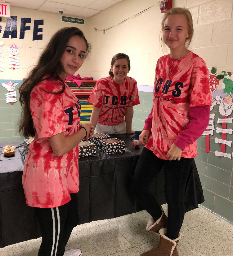 Three female TCHS students smile for camera at Beaver Creek's Trunk or Treat event.