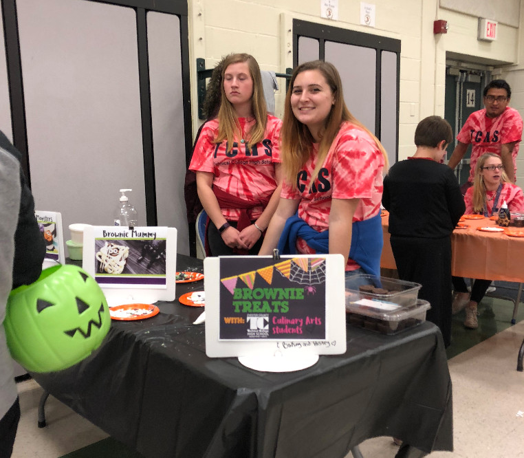 Two female TCHS students volunteer at Beaver Creek's Trunk or Treat event.