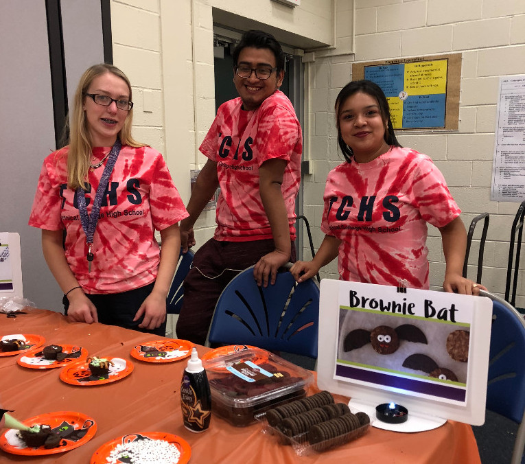 TCHS students help with food crafts during Beaver Creek's Trunk or Treat event.
