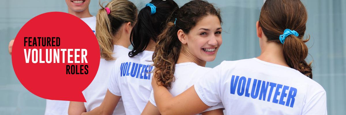 Featured volunteer roles with volunteers standing in unison